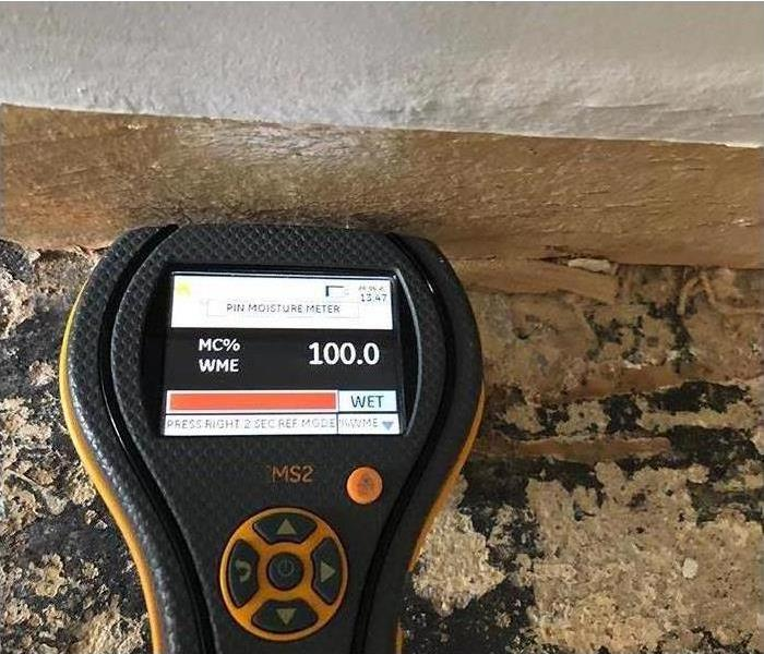 moisture meter reading during water damage investigation
