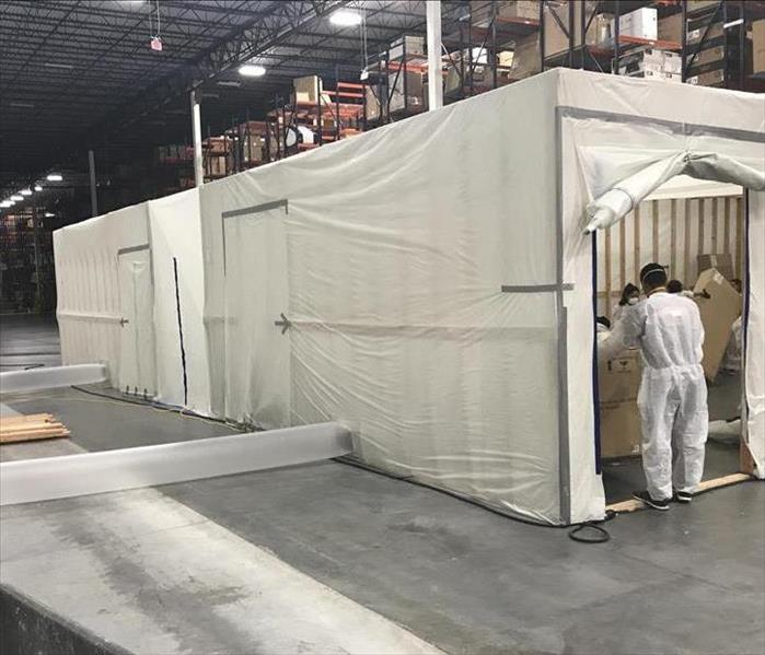 Commercial warehouse on-site clean room setup for mold remediation by professional property restoration experts